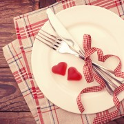 Valentine day love beautiful. Romantic dinner, tableware and hearts on wooden background.